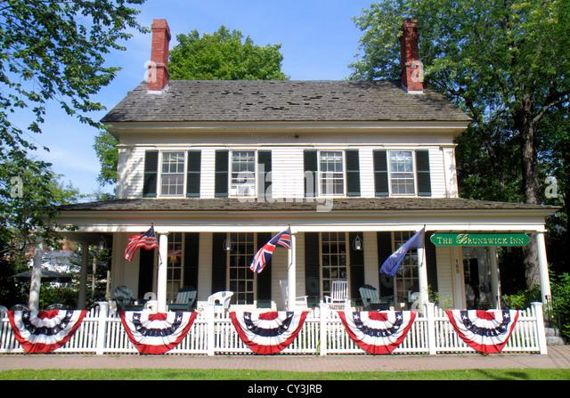 Maine Brunswick Park Row The Brunswick Inn patriotic bunting picket fence Americana - Stock Image