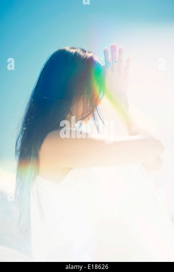 Woman going into her third eye energy. - Stock Image