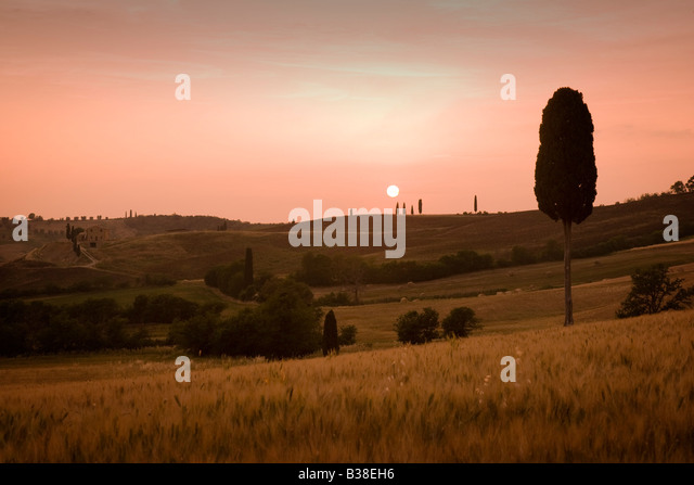 Sunset over landscape near Pienza in Tuscany in Italy - Stock Image