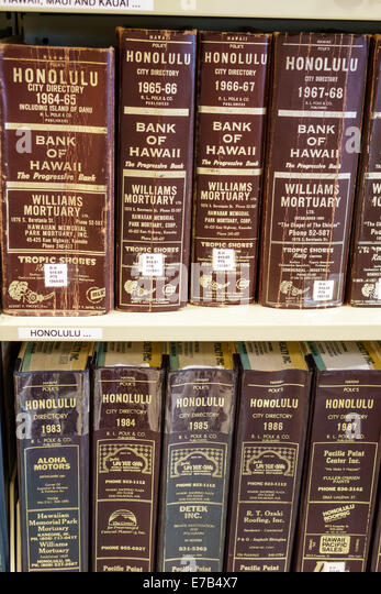 Hawaii Hawaiian Honolulu Hawaii State Library book shelves reference books directories city directory annual - Stock Image