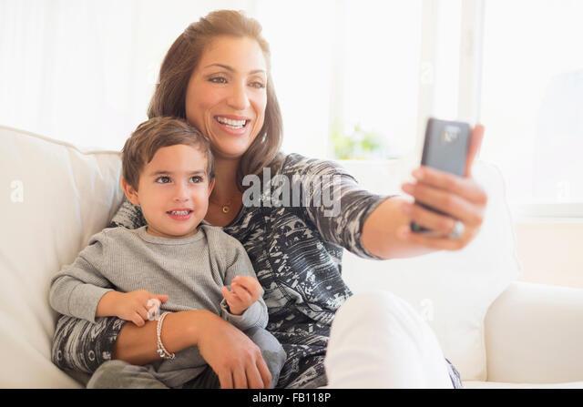 Mother taking selfie son (2-3) - Stock Image
