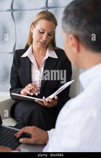 Smiling persons in an office. - Stock Image