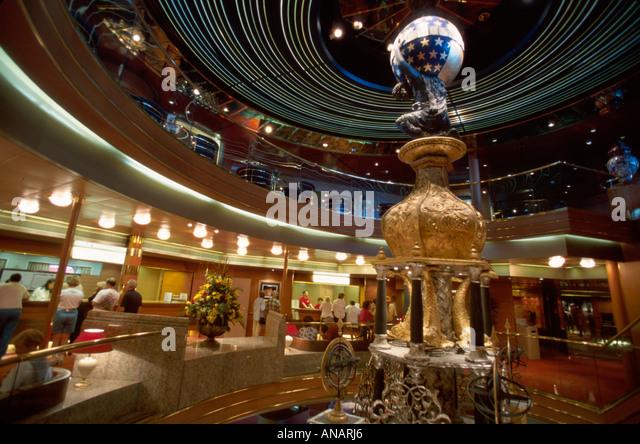 Italy Holland America Line ms Rotterdam cruise ship Atrium 14 clock centerpiece lobby - Stock Image