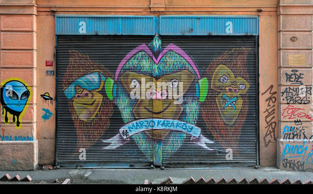 Istanbul, Turkey - April 18, 2017:  Closed shop exterior with metal door covered with colorful graffiti at Hoca - Stock Image