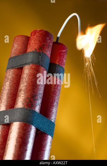 Dynamite sticks with lit fuse - Stock Image