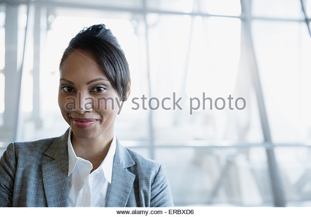 Portrait confident businesswoman with black hair - Stock Image
