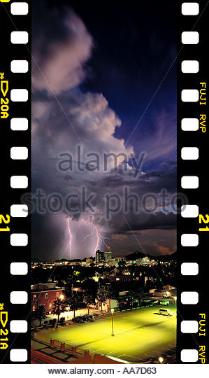 Vertical Panorama Lightning over Down Town Tucson Arizona with  Sprocket Holes High Res - Stock Image