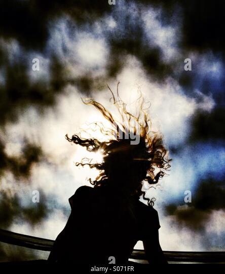 Hair flying on girl bouncing on trampoline - Stock-Bilder
