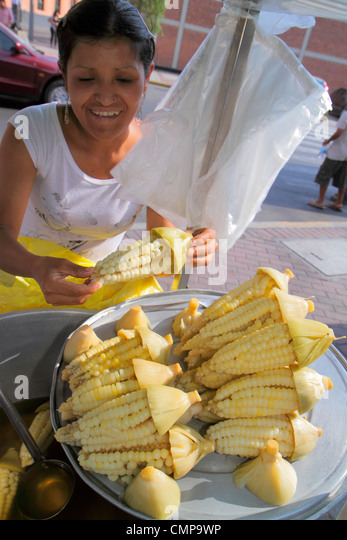 Lima Peru Jiron de la Union street food vendor Cuzco Maize corn on the cob choclo kernel Hispanic indigenous woman - Stock Image