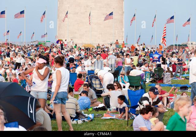 Washington DC D.C. Crowds gather around the base of the Washington Monument waiting for the fireworks on the Fourth - Stock Image