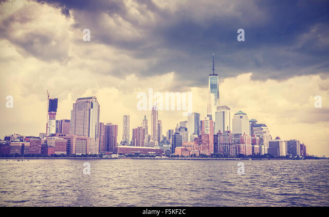 Vintage toned picture of New York waterfront before with dramatic sky, USA. - Stock Image