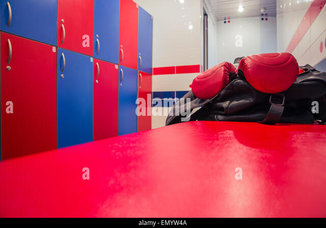 Closeup image of a bag with boxing gloves in locker room - Stock-Bilder