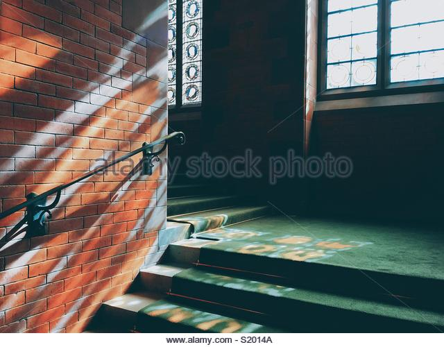 Colorful windows lights on the stairs. - Stock Image