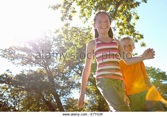 Children walking in forest - Stock-Bilder