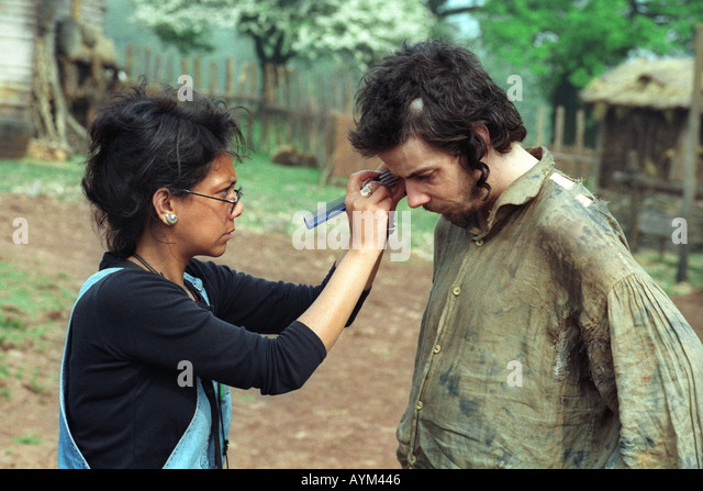 Makeup artist adjusting actor Noah Taylor's hair on the filmset of 'Simon Magus' being shot near Llangynidr - Stock-Bilder