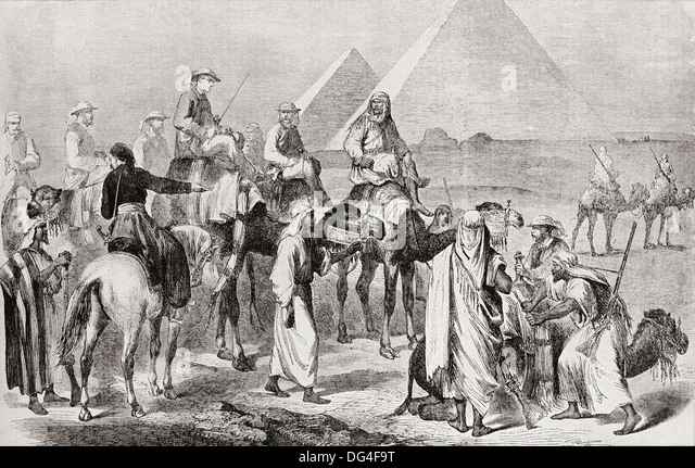 Victorian tourists at the pyramids of Giza, Egypt in the nineteenth century. - Stock Image