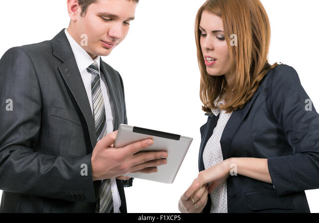 Young officially dressed people having discussion with tablet - Stock Image