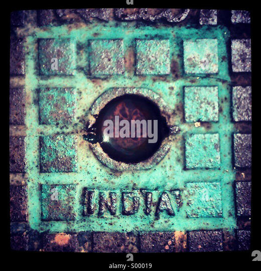 Looking down at an Indian drain cover - Stock-Bilder