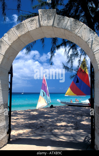Barbados beach Caribbean Beach sailboats and trees seen through an arch - Stock Image