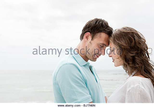 Couple by the sea - Stock Image