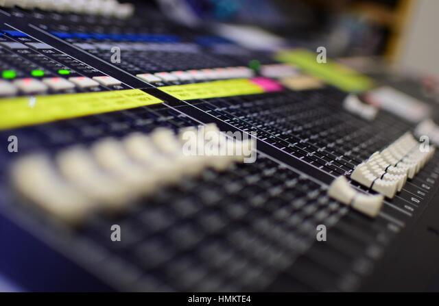 Shallow Depth-of-field Generic Photo of Concert Music Broadcast Soundboard Mixer and Equalizer with Sliders - Stock-Bilder