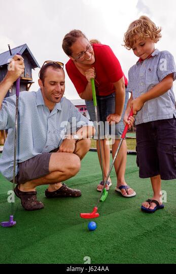 Indiana Valparaiso Zao Island Entertainment Center miniature golf fountains family entertainment man woman boy putting - Stock Image