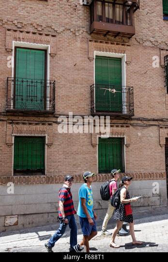 Spain Europe Spanish Hispanic Toledo Asian man woman couple exploring - Stock Image