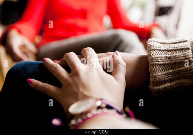 Cropped image of woman with hands clasped - Stock-Bilder