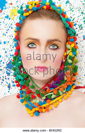 Young woman wearing colourful headdress - Stock Image