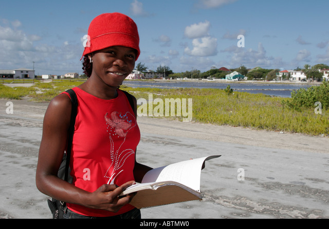 Grand Turk Cockburn Town Black female student notebook - Stock Image