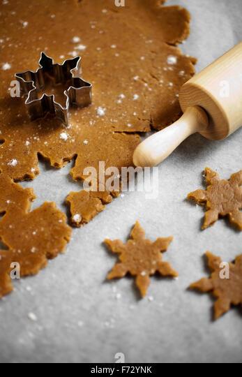Baking star shape christmas cookies - Stock Image