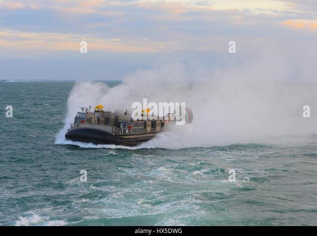 A landing craft air cushion (LCAC) enters the well deck of amphibious dock landing ship USS Carter Hall (LSD 50), - Stock Image