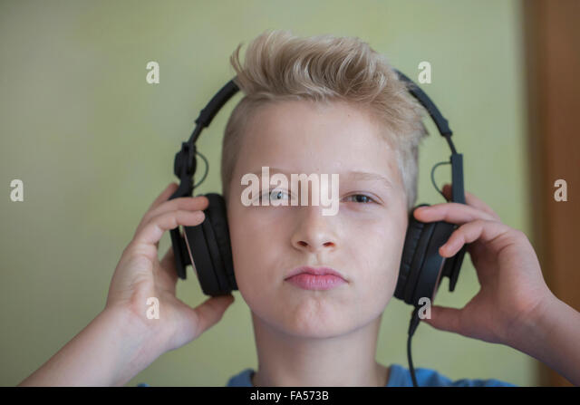 Portrait of a boy listening to music with headphones, Freiburg im Breisgau, Baden-Württemberg, Germany - Stock-Bilder