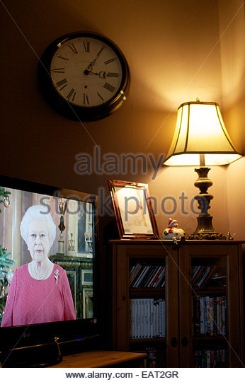 The Queen's Christmas speech, on television in a family living room. - Stock Image