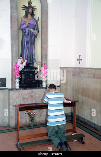Panama City Panama Calidonia Catholic church Jesus Christ purple robe flowers statue statuary religion icon Hispanic - Stock Image