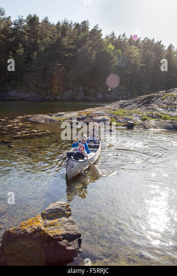 Sweden, West Coast, Bohuslan, Flato, Boys (10-11, 12-13) canoeing on river - Stock Image