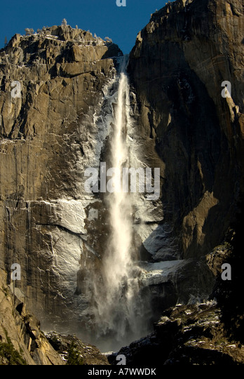 Yosemite Falls waterfall flowing water light snow - Stock Image