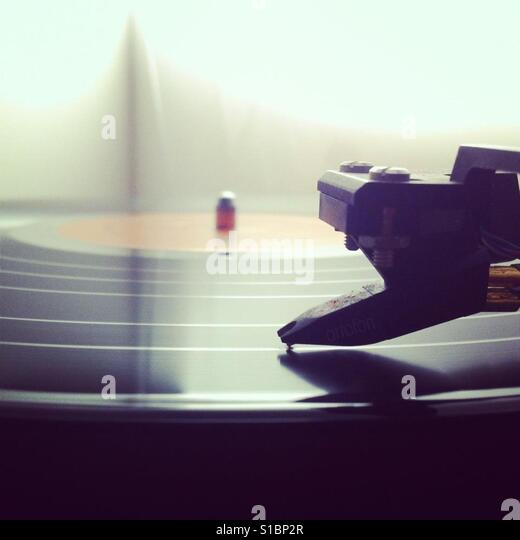 Close up of a record being played on a turntable - Stock Image
