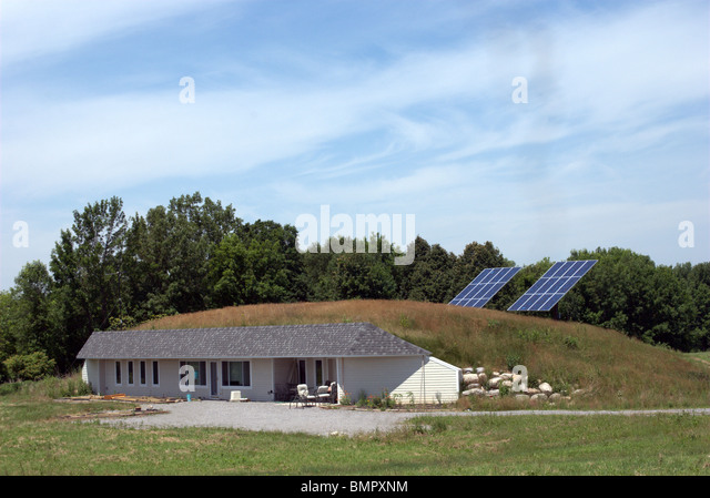 Environmental energy efficient personal home includes thermal heat and air cooling, solar panels, water well for - Stock Image