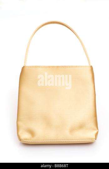 Golden woman's handbag on a white background - Stock Image
