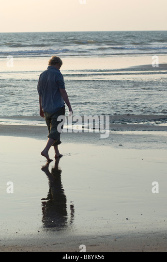 A man walking by the sea Goa India. - Stock-Bilder