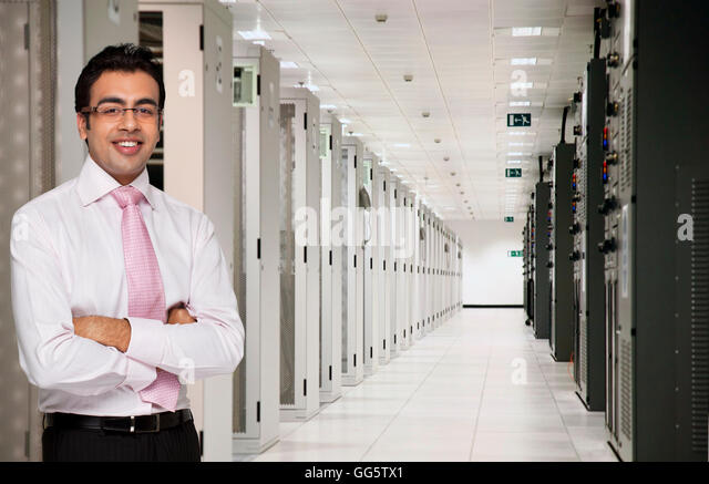 Portrait of male executive in server room - Stock-Bilder