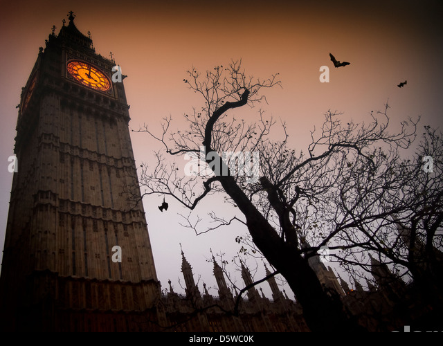 The spooky clock tower of Westminster with a bare tree and flying bats - Stock-Bilder
