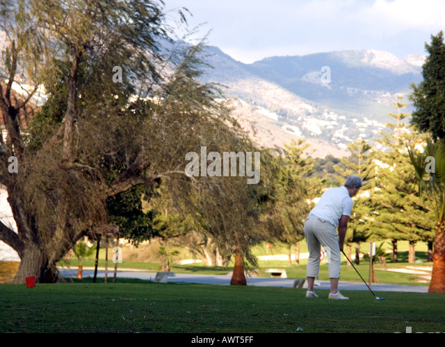 Golfer with Golf bag on the Fairway on a Mountain Golf Course, Mijas, Costa del Sol, Spain - Stock Image