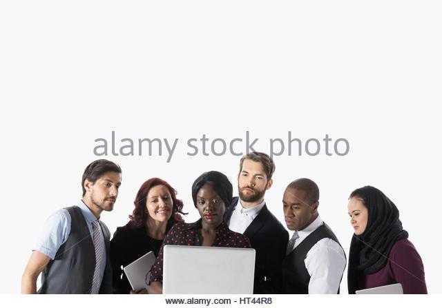 Business people sharing laptop against white background - Stock-Bilder
