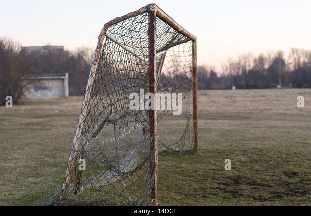 Old rusty soccer goal on sunset, nostalgia concept - Stock-Bilder