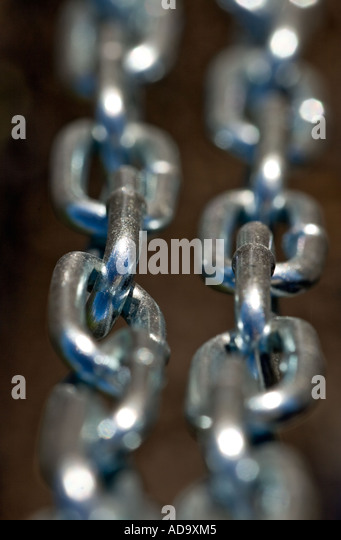 Two parallel, new, shiny stainless steel chains - Stock Image