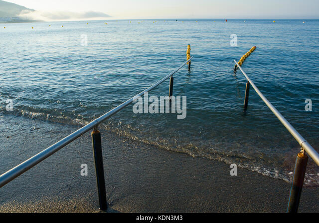 Handrails on beach for disabled people. Comfort place for handicap. Ceuta, Spain - Stock Image