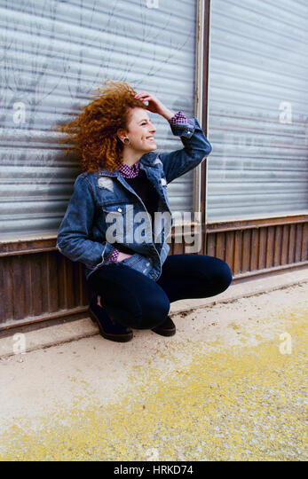Portrait of a beautiful redhead teenager - Stock Image