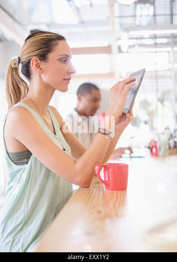 People in coffee shop - Stock Image